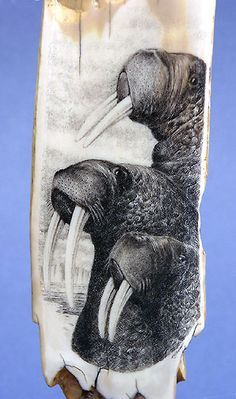 """ARCTIC TRIO II Scrimshaw on fossil walrus artifact (ice axe) on Bolivian rosewood, ebony and abalone mount 10.5""""H x 3.5""""W x 3.5""""D (overall)"""