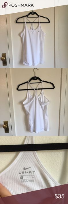 Nike Dri-Fit Racer-back Top No stains, nothing wrong with it. Just don't like working out in white Nike Tops Tank Tops