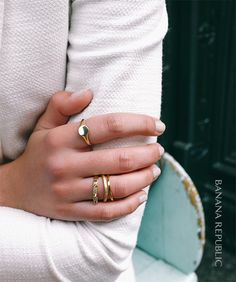 You can never have too many pieces of gold, delicate jewelry. Create your own look by stacking rings in different textures, shapes and sizes on lots of fingers. With accessories, more is more.