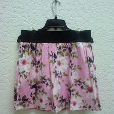 Derek Heart Pink and White Floral A-Line Skirt Derek Heart brand from Kohl's, size large. Third photo shows pin holes from where I safety pinned it to fit on my waist rather than my hips, and it is in otherwise excellent condition! Black band at top is entirely elastic and very stretchy. Skirt is not lined but not sheer. Please ask any and all questions before purchasing. Thanks! Derek Heart Skirts A-Line or Full