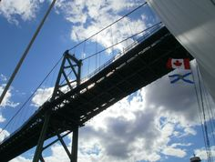 Sailing under the MacDonald bridge in Halifax NS Sailing, Bridge, Clouds, Travel, Candle, Voyage, Viajes, Boating, Bro