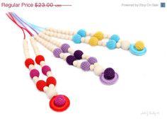 He encontrado este interesante anuncio de Etsy en https://www.etsy.com/es/listing/150658391/on-sale-nursing-necklace-pendant-organic