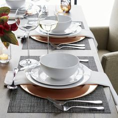 Dressing up or down with ease, Aspen's trim crisp lines in bright white porcelain looks beautiful on its own or layered with colored or patterned dinnerware.
