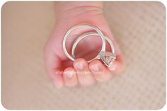 Newborn - use the mothers/fathers rings to accentuate baby's tiny hands