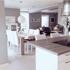 Grey tone open plan kitchen, lounge and diner
