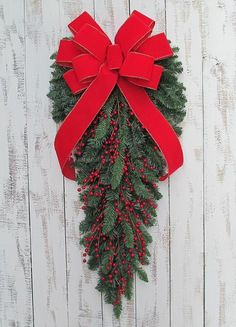 Christmas Red Berry Teardrop Wreath. Great for Christmas and New Year home decor and gifts. Seasonal. Limited quantity available. Measures approx. 30 inches long.