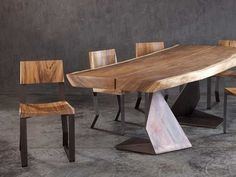 Фотография. Beautiful wood table and chairs. Live edge table. Furniture design. Contemporary furniture pieces.
