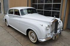 # 17799 This 1961 Rolls-Royce Silver Cloud II Sedan . It is equipped with a 3 Speed Automatic transmission. The vehicle is White with a Tan interior. - 1961 Rolls Royce Silver Cloud II left hand drive, long wheel base with factory partition. White with Tan Leather . The car is in very good condition. There were only hand full of long wheel drive made with factory partition. For only $56500 - AM-FM - Contact Internet Sales at 718-545-0500 or gullwingny@aol.com for more information. - -