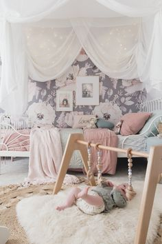 The Modern Monty Wooden Baby Play Gym with baby Ollie in his big sisters incredible room! Floral Modern goodness