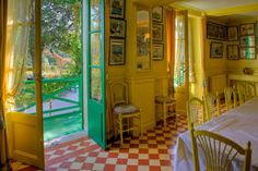 Claude Monet house, France. I love the color, patterns, textures and furniture