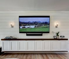 Custom floating media cabinet by Design Directions in Oklahoma City in white lacquer and stained maple on a custom shiplap wall. Floating Media Cabinet, Floating Cabinets, White Media Cabinet, Basement Family Rooms, Tv Wall Cabinets, Media Cabinets, White Shiplap Wall, Basement Makeover, Living Room Tv