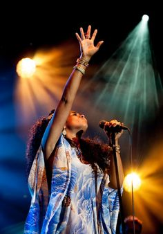 Lover of the light. Kelis reaches for the stars during a performance on July 14 in London