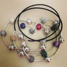 3 silver pandora essence bracelets and 1 leather bracelet