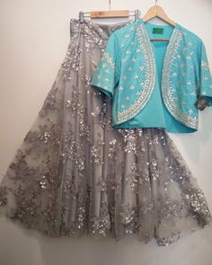 What a Colour Combination! A Grey Lehenga with handwork on it & Light Blue Shrug & Embroidery on it To customised this garment log on to www. Indian Attire, Indian Ethnic Wear, Indian Wedding Outfits, Indian Outfits, Western Dresses, Indian Dresses, Indian Lehenga, Lehenga Choli, Lehenga Style