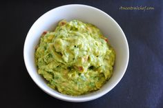 I started with two ripe avocados, sliced them in half, took out the big stone inside, and then scooped out the flesh using a spoon. Paleo Guacamole Recipe Mash up the avocado flesh with a spoon or fork. Add in juice from half a lime (add more if you prefer it more limey). Dice a tomato, de-seed and finely chop a