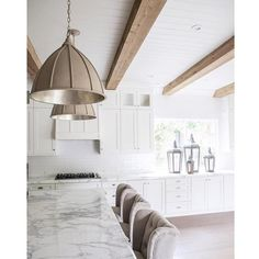 Such a cool kitchen design by @nicoledavisinteriors. Those beams + pendants!  More kitchen inspo pics on Beckiowens.com.  Have a great day. @bellaboho