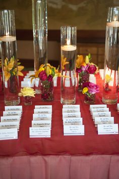 This was awesome looking - Floating candles and arrangements for the placecard table at Eaglewood Resort - Geneva + Erik's Wedding - Kelly Vanderploeg Photography