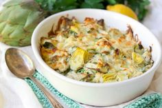 (Ad) This Healthy Spinach Artichoke Chicken Casserole is total comfort food. It's easy to make, packed with protein, brimming with spinach and artichoke hearts and full of flavor. | Recipes to Nourish | Healthy Dinners | Gluten-free dinner recipes | Grain-free dinner recipes | healthy casserole | Easy gluten-free meals || #glutenfreedinners #healthymeals