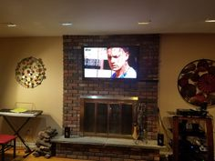 Current fire place brick LCD TV over