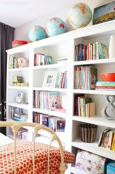 Add color and coziness to your cottage bedroom with large bookshelves showcasing your favorite DIY decor and book collection.