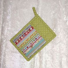 Handmade pot holder featuring designer fabric in retro kitchen tools, cupcake and cherry images and a coordinating green pattern adds fun to