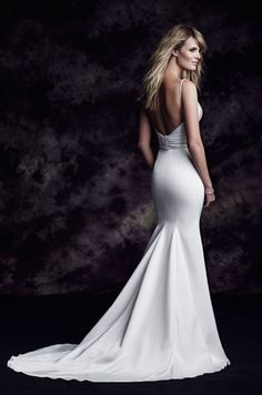 Paloma Blanca Style 4603: Paloma Satin Wedding Dress. Satin plunging neckline with beaded insert and beaded straps. Ruched waist cummerbund, fit and flare satin skirt. Swarovski buttons. Chapel Train. #PalomaBlanca #weddingdress #weddinggown #wedding #dress