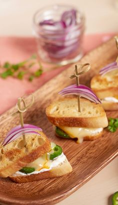 Mini Jalapeño Popper Grilled Cheese appetizers. Celebrate your favorite sandwich with these delicious party-perfect mini grilled cheese recipes featuring Arla cheese slices.