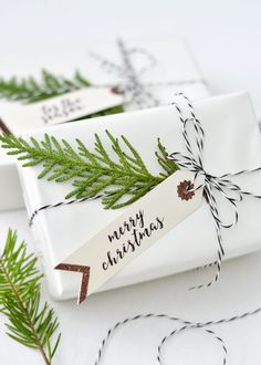 love this plain white paper with black and white butchers string and conifer green leaves foliage christmas holiday festive gift wrap idea