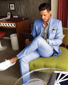Consider teaming a light blue suit with a blue print button-down shirt for a sharp, fashionable look. Make white plimsolls your footwear choice for a more relaxed aesthetic. Shop this look on Lookastic: https://lookastic.com/men/looks/light-blue-suit-blue-long-sleeve-shirt-white-plimsolls/21067 — Light Blue Suit — White Print Pocket Square — Blue Print Long Sleeve Shirt — White Plimsolls