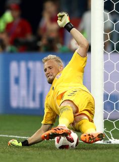 Kasper Schmeichel of Denmark saves the first penalty from Milan Badelj of Croatia in the penalty shoot out during the 2018 FIFA World Cup Russia. National Football Teams, Men's Football, Kasper Schmeichel, Penalty Shoot Out, Sports Celebrities, Action Poses, Goalkeeper, Fifa World Cup, Leicester