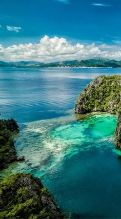 Drone Views of Coron Island, Philippines.  Dramatic limestone cliffs, crystal clear water with varying shades of blue and a stunning interior or sacred lakes make this island a special place. Photo Location: Coron Island, Philippines by the Divergent Travelers Adventure Travel Blog. Click to see all of the Amazing Drone Photos of the Philippines at  http://www.divergenttravelers.com/drone-photos-of-the-philippines/
