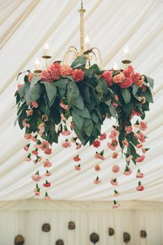 With eucalyptus and carnations in shades of pink laced together, this floral chandelier takes your breath away! It would be stunning suspended in an indoor reception venue. Chandelier Design, Flower Chandelier, Chandelier Ideas, Chandelier Wedding, Kitchen Chandelier, Chandeliers, Diwali Decorations, Wedding Decorations, Lustre Floral