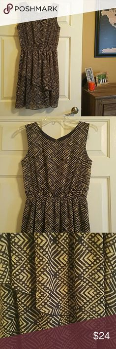 """Sleeveless Ruffle Dress This beautiful dress can be dressed up with heals for work or a party.  Worn once, maybe twice, and is in fabulous condition.  I am about 5'4"""" and this dress hits me right at the knees.  100% Polyester Enfocus Studio Dresses"""
