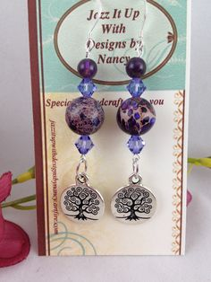 EarringsHandmade Beaded Purple Imperial Jasper Tree of Life Pewter. Royal Imperial Jasper is one of the most beautiful purple gemstones with rich grains of copper, beige, lavender and other colors. It is highly variant and each stone is just so elegant. Amethyst gemstone is a rich purple with lighter areas almost to a lavender tone. Purple Swarovski Crystals are in a lighter contrasting purple and very translucent with diamond cut to emphasize the sparkle and pick up the surrounding light.