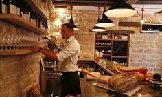 France is known for its wines, so one must go to a wine bar.  There are so many to choose from, and they are all so full of history.