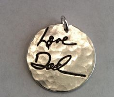Memorial Jewelry. Your loved one's hand writing imprinted on a piece of jewelry. Beautiful. I will have to do this.