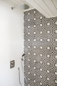 shower wall with moroccan tiles concrete wall, scandinavian interior, bathroom