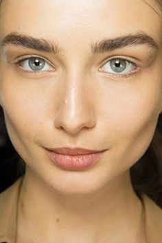 Very minimal makeup, the eyes where left bare and skin lightly prepped at Balmain Fall/Winter 2014-15