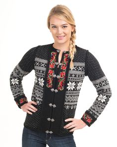 You will simply love, love, love, this classic 100% Norwegian Wool cardigan by Vrikke. The Setesdal sweater is the most iconic Norwegian sweater and this 100% Merino Wool Setesdal Cardigan is no exception. We adore the way the colorful embroidery of flowers and swirls pops out against the black trim along the cuffs of the sweater and along the middle edges which gather from the center to the neckline. We also can't get enough of the charming silver clasps that run the length of the cardig...