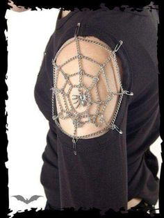 Open sleeve, chain web with spider.