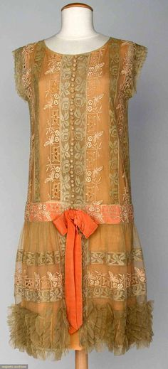 "LACE TEA DRESS, MID 1920s Embroidered cream net w/ ecru filet lace insertions, salmon underdress & ribbon at low waist, B 36"", L 40"", (bow in front torn) excellent. via Augusta Auctions."