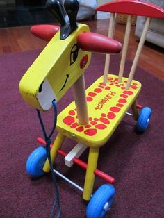 Here's a blast from the past!  Vintage 1966 Playskool wooden ride on/pull toy giraffe.  Currently listed at auction to end Sunday June 24.