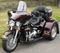 harley davidson trike/my husband wants this one for us to go cross country with. Um maybe?