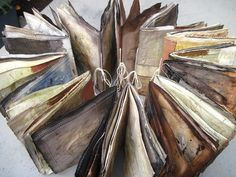 13 Books made into one. Hand-machine stitched and ecoprinted on heavy watercolourpaper