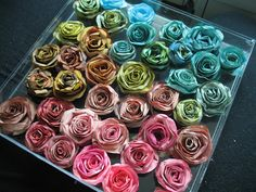 La Dolce Villa: DIY! Coffee Filter Roses -cut into spiral, sponge colour on allow to dry and curl