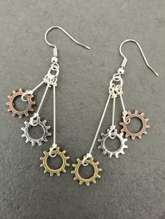 I originally designed these for a customer who wanted a pair of dangle earrings to match her 14 Speed Necklace she bought on my website. I liked how they turned out so much, I decided to add them to my store (and I made a pair for myself!). -Each earring features 3 small chairing