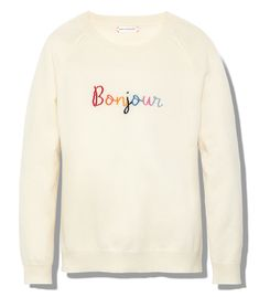 $375 Ivory sweater featuring multicolor 'Bonjour' embroidered text. ShopBazaar, shop designer clothing, shoes and accessories selected exclusively by the editors at Harper's Bazaar.