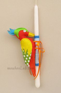 Easter candle with orange woodpecker doll  Easter by mouhoxlab