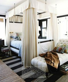 Love the striped rug over the sisal and the black walls with lots of white.