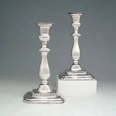 A Rare Pair of Early American Silver Candlesticks,  Maker: A.E. Warner, Baltimore, MD, c.1814,  Dimensions: 9 1/2''(H) -   Pairs of American candlesticks made prior to 1820 are exceptionally rare, and there are no other examples from Maryland known